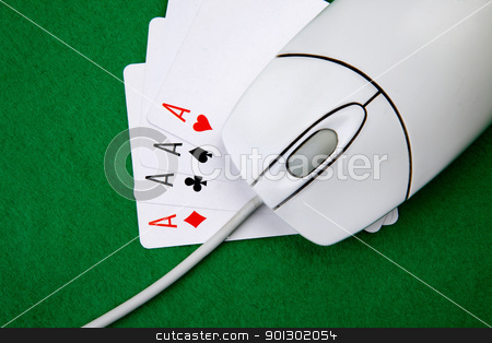Online Games stock photo, An online gaming concept with computer mouse, four aces and green felt by Tyler Olson