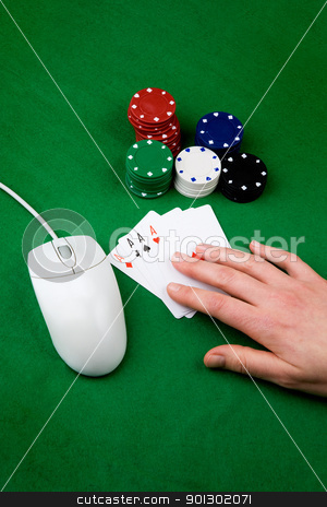 Online Gamble stock photo, An online gambling concept - computer mouse, hand and casino chips by Tyler Olson