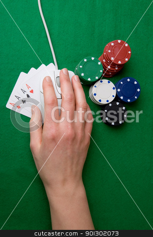 Online Poker stock photo, An online gambling concept - computer mouse, hand and casino chips by Tyler Olson