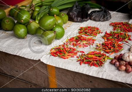 Vegetable and Fruit Market stock photo, A thrid world food market with chilli and fruit by Tyler Olson