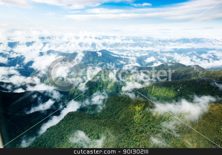 Indonesian Mountains stock photo, A mountain range in Papua, Indonesia by Tyler Olson