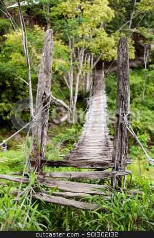 Hanging Bridge stock photo, An old narrow hanging bridge by Tyler Olson