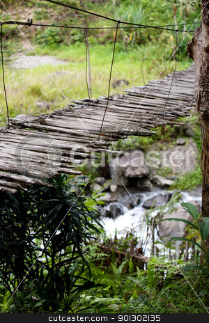 Hanging Bridge Detail stock photo, An old narrow hanging bridge by Tyler Olson