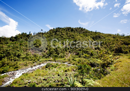 Tropical Mountain Landscape stock photo, A tropical mountain landscape in Papua, Indonesia by Tyler Olson