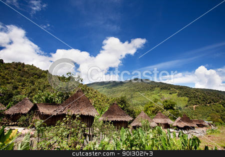 Traditional Mountain Village stock photo, A traditional village in Papua, Indonesia by Tyler Olson