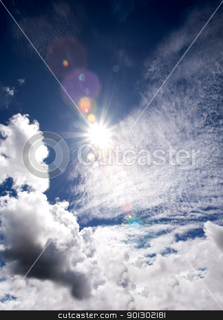 Sunburst stock photo, The sun in a blue sky by Tyler Olson