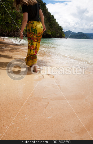 Walk on Beach stock photo, A female walking on the beach by Tyler Olson