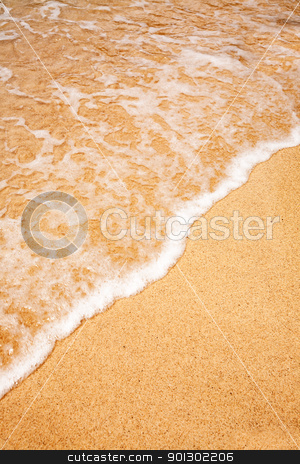 Wave Sand Background stock photo, A background of a wave breaking on a sandy beach by Tyler Olson