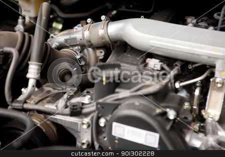 Diesel Motor stock photo, A detail of a diesel motor with focus on the turbo by Tyler Olson