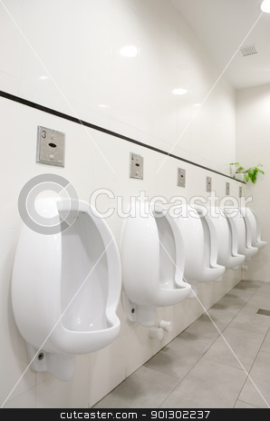 Public Bathroom stock photo, A mens public bathroom with urninals on the wall by Tyler Olson