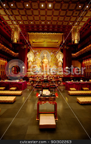 Buddhist Temple stock photo, An interior of a Buddhist temple with a Buddha statue by Tyler Olson