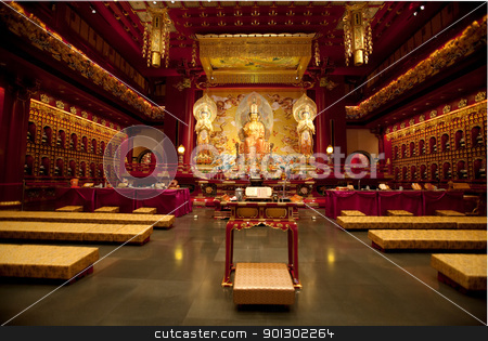 Buddhist Temple stock photo, Interior of a Buddhist temple with many statues by Tyler Olson