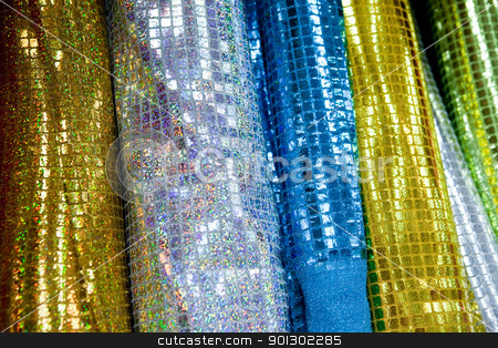 Glitter Cloth stock photo, A background of various rolls of sparkly cloth by Tyler Olson