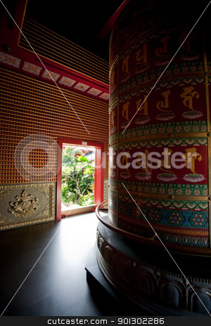 Buddhist Temple Abstract stock photo, Interior of a Buddhist temple with a prayer wheel by Tyler Olson