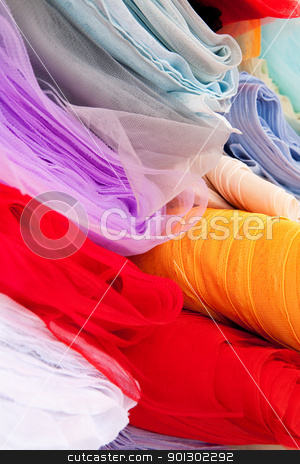 Silk Cloth stock photo, A background of various rolls of cloth by Tyler Olson