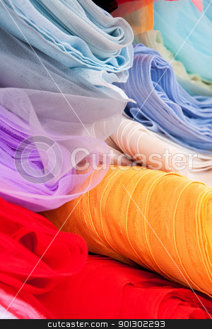 Cloth stock photo, A background of various rolls of cloth by Tyler Olson