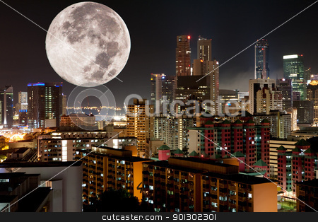 Moon Night City stock photo, A very large moon rising over a metropolis by Tyler Olson