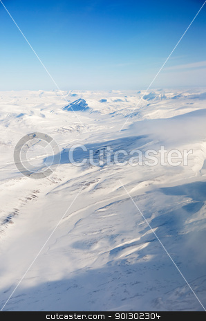 Aerial of Svalbard stock photo, A snow covered mountain landscape - Spitsbergen, Svalbard Norway by Tyler Olson