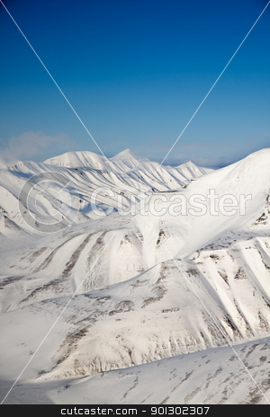 Snow Mountain Range stock photo, A snow covered mountain range in Svalbard by Tyler Olson