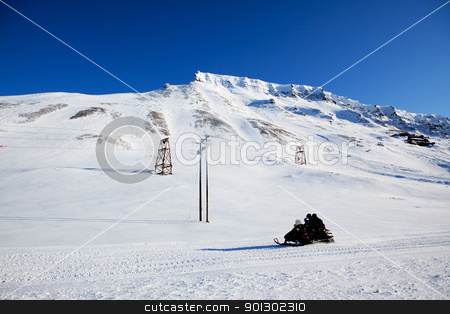 Mountain Winter Landscape stock photo, A winter landscape with a snowmobile by Tyler Olson