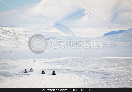 Snowmobile in Svalbard stock photo, A group of snowmobiles on the ice outside Longyearbyen, Svalbard Norway by Tyler Olson