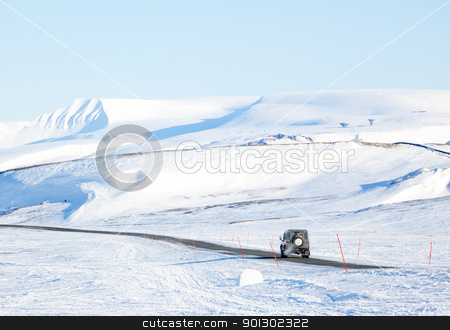 Truck in Winter stock photo, A truck driving on a barren landscape of snow and ice - Svalbard, Norway by Tyler Olson
