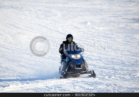 Snowmobile stock photo, A snowmobile isolated against a winter snow landscape by Tyler Olson