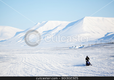 Arctic Landscape stock photo, An arctic landscape with a snowmobile in the foreground by Tyler Olson