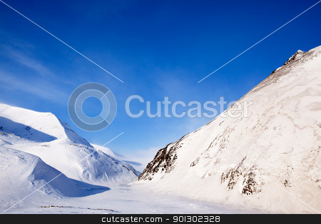 Svalbard Mountains stock photo, Mountains on the island of Spitsbergen, Svalbard, Norway by Tyler Olson