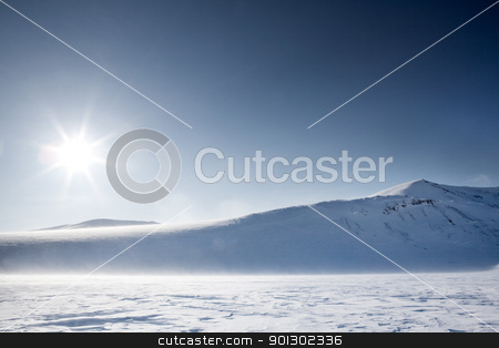 Winter Mountain Landscape stock photo, A wilderness winter mountain landscape looking into the sun by Tyler Olson