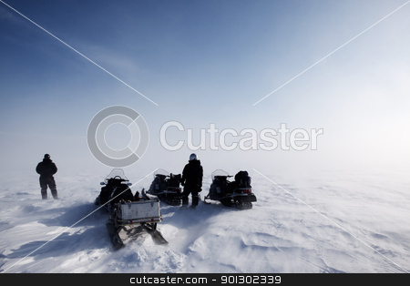 Blowing Snow Landscape stock photo, A blowing snow landscape with three snowmobiles on an expedition by Tyler Olson