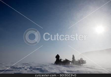 Blizzard stock photo, A pair of snowmobiles in a winter blizzard with blowing snow by Tyler Olson