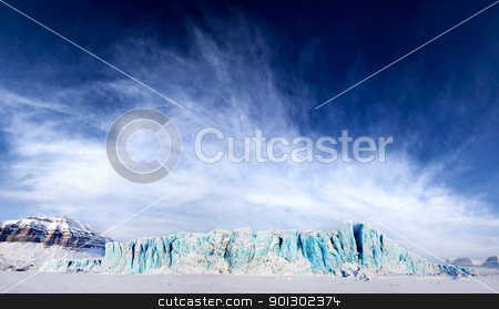 Glacier stock photo, A dramatic panorama of a glacier on Spitsbergen Island, Svalbard, Norway by Tyler Olson
