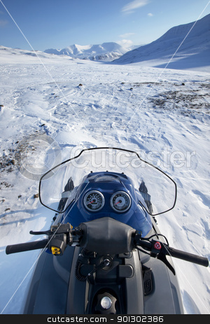 Snowmobile Winter Landscape stock photo, A snowmobile on a winter wilderness landscape by Tyler Olson