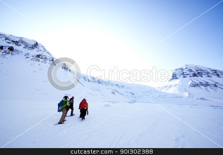 Winter Tourism stock photo, A group of people treking across a winter landscape by Tyler Olson