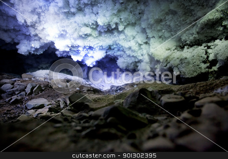 Ice Cave stock photo, A dark and mysterious snow ice cave - A glacial grotto by Tyler Olson