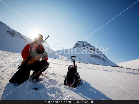 Female Adventurer with Gun stock photo, A female adventure loading a rifle as a safety precatuion, Svalbard, Norway by Tyler Olson