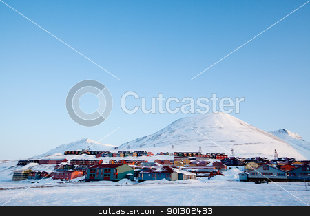 Longyearbyen stock photo, A detail of Longyearbyen, Svalbard, Norway.  A row of houses and a mountain in the distance. by Tyler Olson