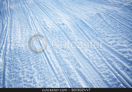 Snowmobile Track Texture stock photo, A snow texture of snowmobile tracks converging into the distance by Tyler Olson