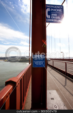 Suicide Hope stock photo, A suicide emergency phone on the San Francisco Bridge with the sun signifying hope by Tyler Olson