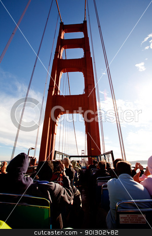 Tousit Bus stock photo, A tousit bus on the Golden Gate Bridge by Tyler Olson