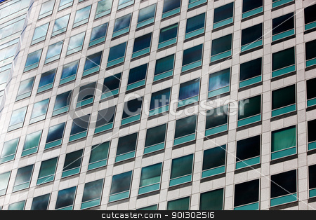 Window Background stock photo, A grid of windows from an office building by Tyler Olson