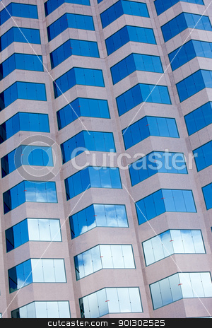 Office Building Abstract stock photo, A grid of windows from an office building by Tyler Olson