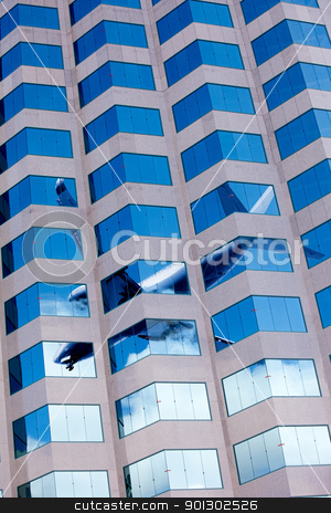 Airplane Office Building stock photo, A reflectino of an airplane in a office window by Tyler Olson