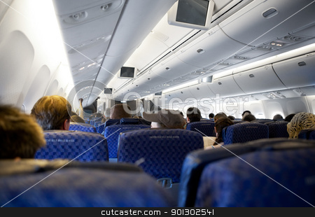 Airplane Interior stock photo, Interor of a passenger airplane - commercial airline by Tyler Olson