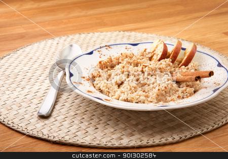 Apple Cinnamon Porridge stock photo, A bowl of porridge with apple and cinnamon spices by Tyler Olson