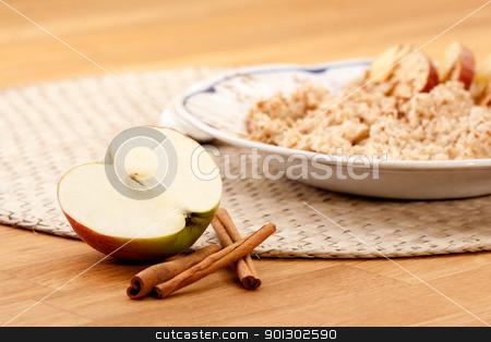 Apple Cinnamon Porridge stock photo, Apple Cinnamon Porridge - shallow depth of field with focus on the apple and cinnamon stick by Tyler Olson