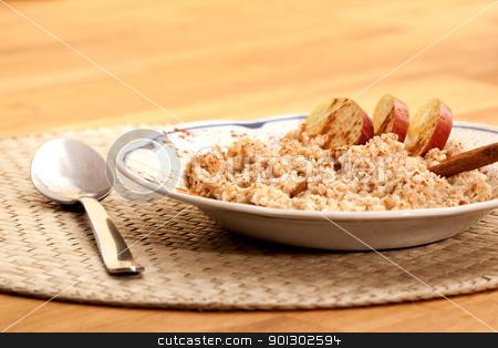 Apple Cinnamon Porridge stock photo, A bowl of apple cinnamon porridge on a wooden table. by Tyler Olson