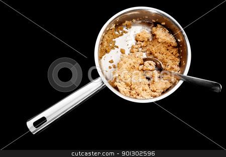 Cold Porridge Pot stock photo, A pot of old cold porridge isolated on black by Tyler Olson