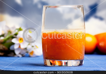 Orange Smoothie stock photo, A fresh orange smoothie made with fresh fruit by Tyler Olson